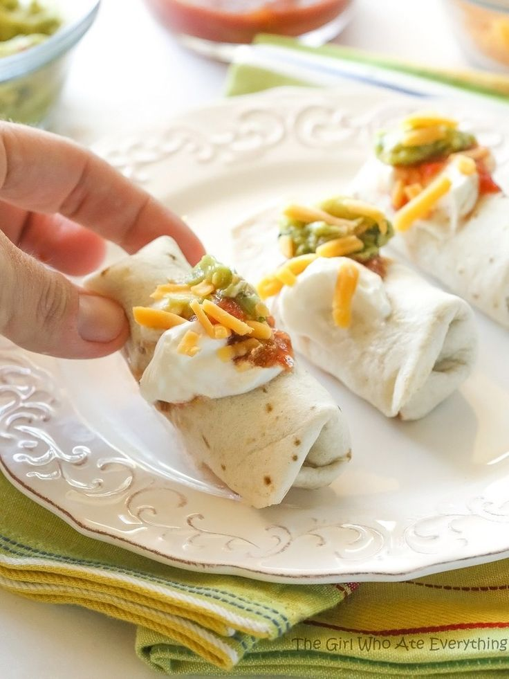 These Mini Burritos are filled with seasoned meat, beans, and cheese. Serve them as an appetizer and let your guests top their own.