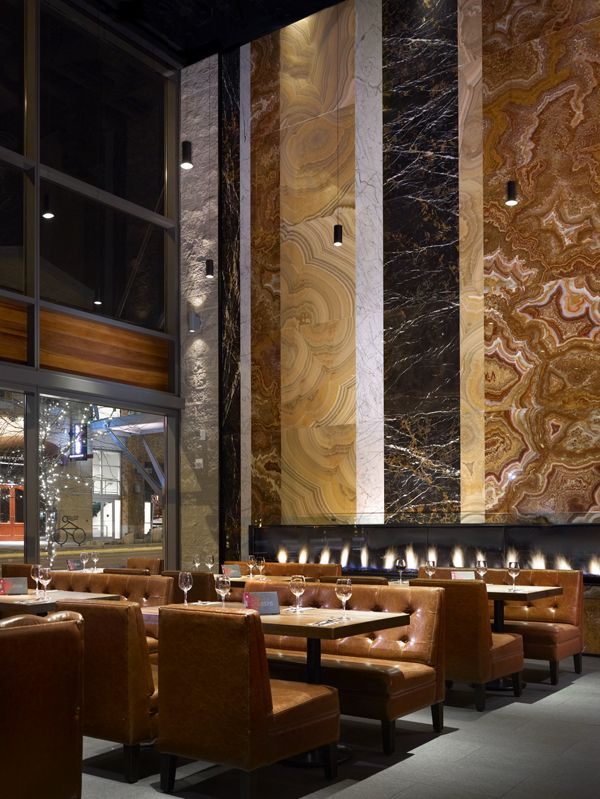 Fireplace Wall - Earls Restaurant creates a feature wall designed by layering different types/colours of metamorphic rock in various sizes around the linear fireplace.  Stunningly beautiful!