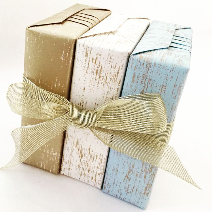 Beautiful paper from Vandoros Fine Packaging made extra special with some gorgeous pleats and a golden bow