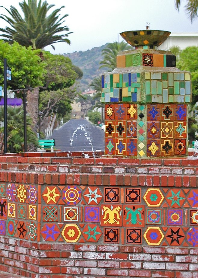 Water fountain at Avalon's harbor displays brightly-colored tiles in the classic Catalina design. Santa Catalina Island.