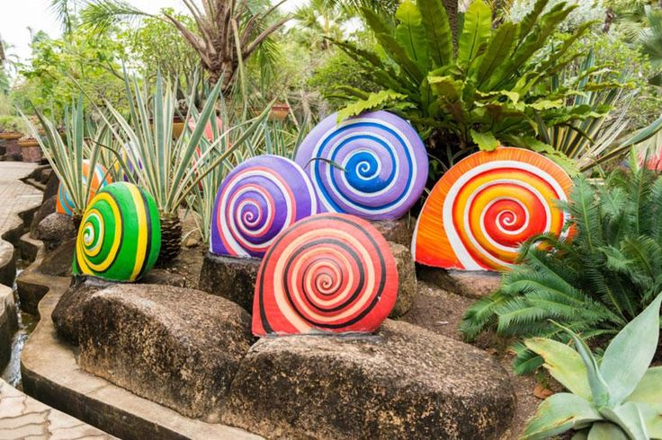 Landscape with colorful snail sculptures giant concrete for Sensory garden designs