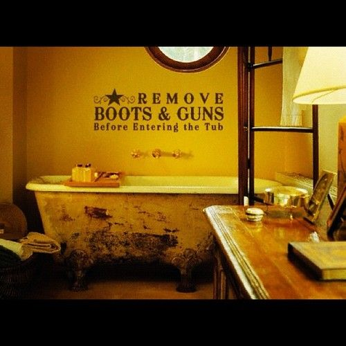 Gotta love it!  Although there should be boots and guns in the pic!  My kind of bathroom, a steel tub would make it even more authentic.