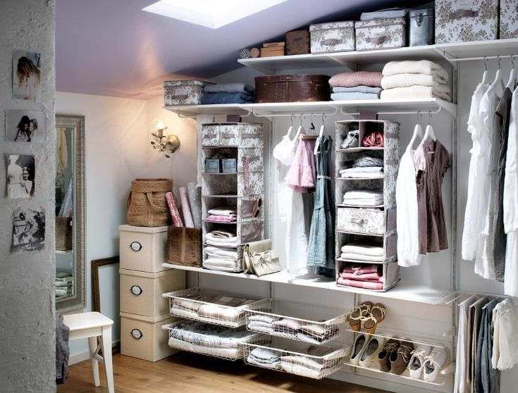 A storage space with algot shelves baskets and clothes for Ikea catalogo cabine armadio