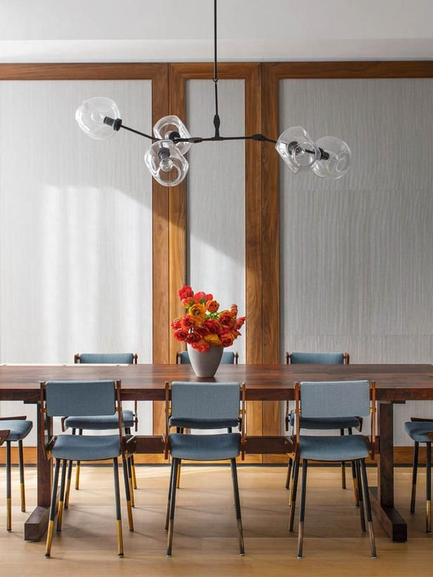 MIDCENTURY MODERN DINING ROOM WITH BLUE CHAIRS, GLOBE LIGHT CHANDELIER