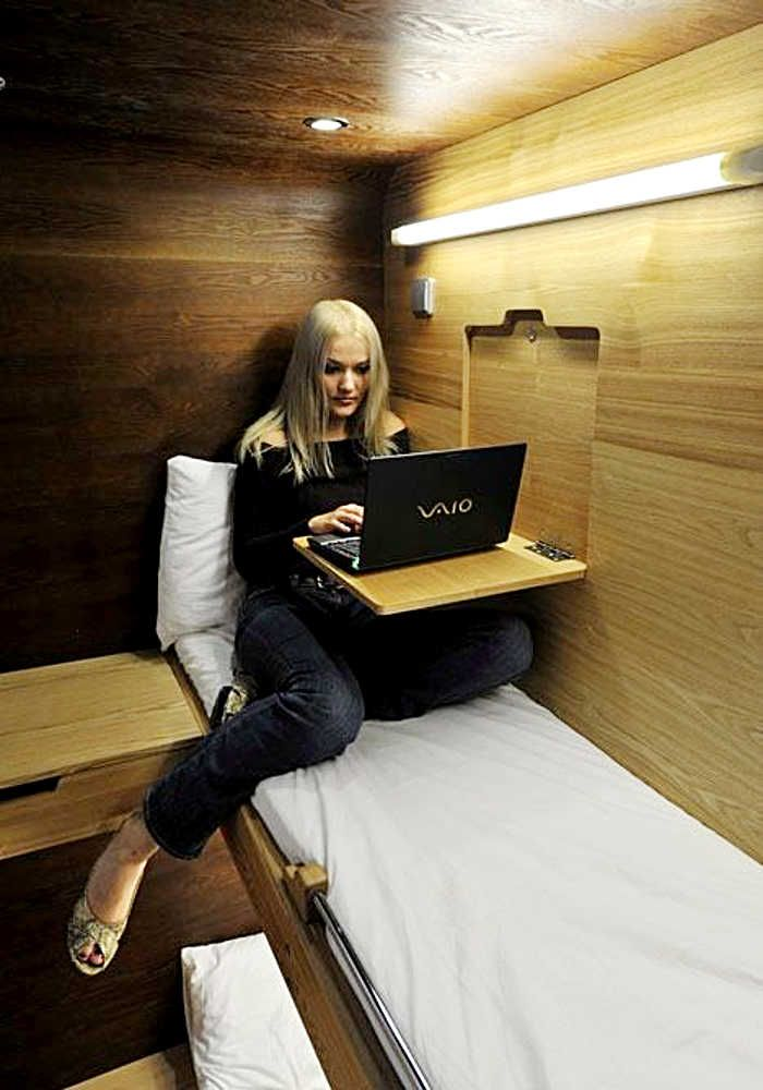 Elegant computer desk, that hides away within the wall of a cargo van.