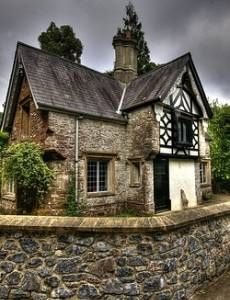 This lovely Tudor cottage features stucco and half-timbering.