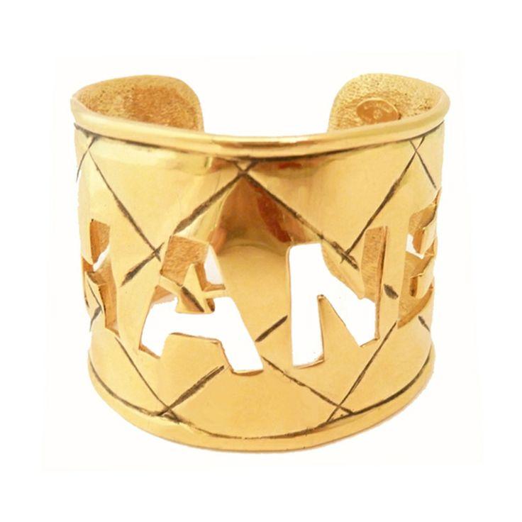 Vintage Signed Chanel Open Logo Cuff Bracelet | From a unique collection of vintage cuff bracelets at http://www.1stdibs.com/jewelry/bracelets/cuff-bracelets/