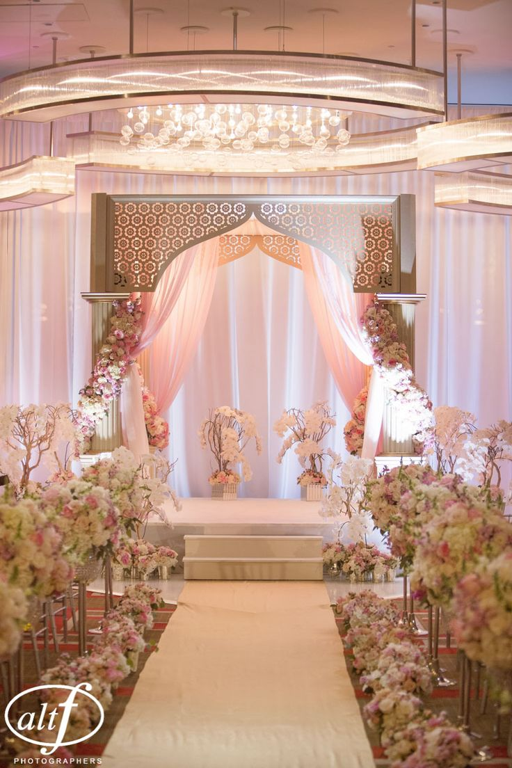 Trees of white orchids surrounded the mandap. Indian Wedding at the Mandarin Oriental. Las Vegas Wedding Planner Andrea Eppolito. Photo by Altf.
