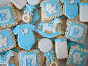 Baby Shower Cookies~                     By oh sugar, blue Onesie, block alphabet, rocking horse, baby buggy, bottle, rattle