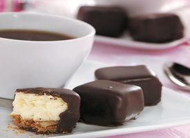 Cheesecake bites...dipped in chocolate...stuffed in your mouth.