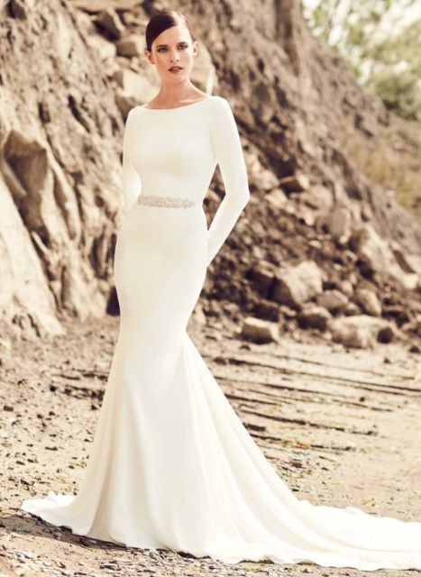MIKAELLA BY PALOMA BLANCA // ONE & ONLY BRIDAL // This long sleeve, crepe dress by MPB is for the bride that is all about high fashion & class. The high neckline and low back are both elegant and sexy, while the button details along the long train add the perfect touch of classic bride.