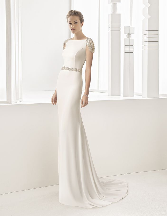 Saboya - Crepe column dress with boat neckline and extra-low jewelled back with frosted beading, available in ivory and natural.