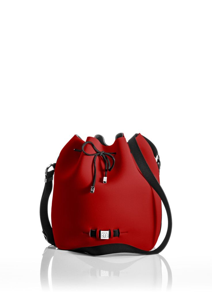 The Bubble is your bucket bag wardrobe staple.  A must-have style alongside totes and cross-bodies for the woman on the go.  With its drawstring closure, side zipper, adjustable strap and spaciousness, this is a practical day-to-day bag or one to take with you on travel adventures!   Size  240 x 175 x 30 mm  320g  Made in Italy  Vegan Friendly  Made from Poly-Lycra Fabric   Red