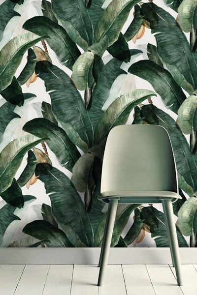 leaf printed green wallpaper and green chair