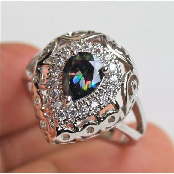 Shop Women's size Various Rings at a discounted price at Poshmark. Description: 18k White Gold filled Mystic Topaz and White Sapphire. Really beautiful ring.. Sold by pric1258. Fast delivery, full service customer support.