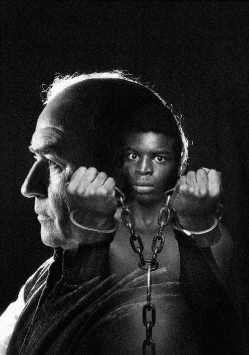 January 23, 1977: Roots, the television mini-series based on Alex Haley's novel premieres on ABC. Roots received 36 Emmy Award nominations and won 9. The 8 episodes received unprecedented Nielsen ratings and the finale still holds a record as the third-highest-rated US television program ever. Photo: Edward Asner as Capt. Thomas Davies and LeVar Burton as Kunta Kinte (ABC Archives)