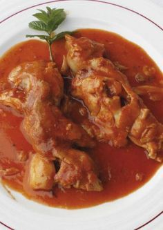 Manitas de cerdo con salsa vizcaína