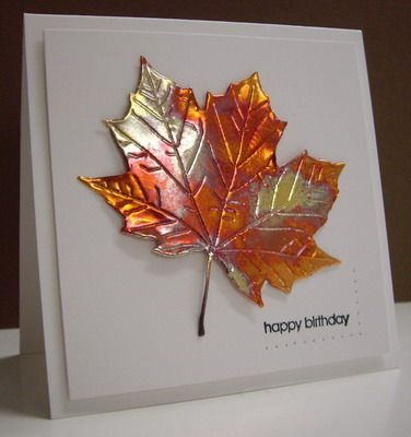 By Loll Thompson. Die-cut from Cheery Lynn. Loll die-cut a piece of copper sheeting, then heated the metal with a mini-butane torch, let it cool, and attached it to the card front. Note: She had to run the die-cut leaf with the copper through her Big Shot several times, and still it didn't cut right through the copper, so she used her scissors to make the final cuts. It embossed well, though!