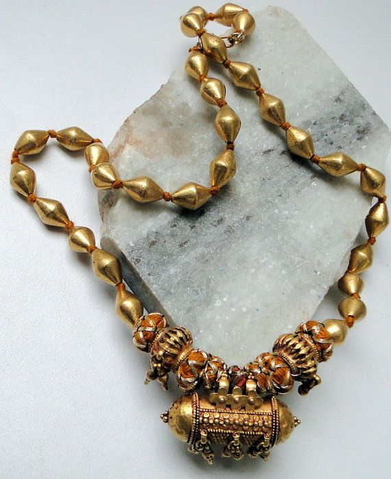 India   An old 22 cart gold necklace from India.