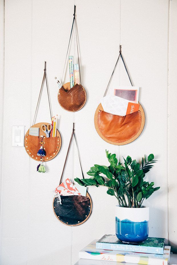 Make these easy catchall wall pockets with corkboard and leather.   54 Ways To Make Your Cubicle Suck Less