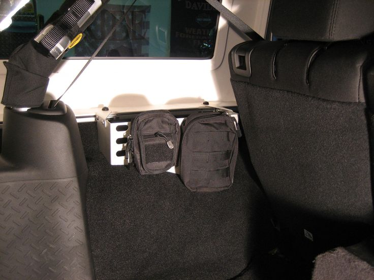 Sharpline Aluminum Products exclusive Jeep® Wrangler JK and JKU rear fender organizer for 2007-2015 model years featuring MOLLE style mounting for accessories.