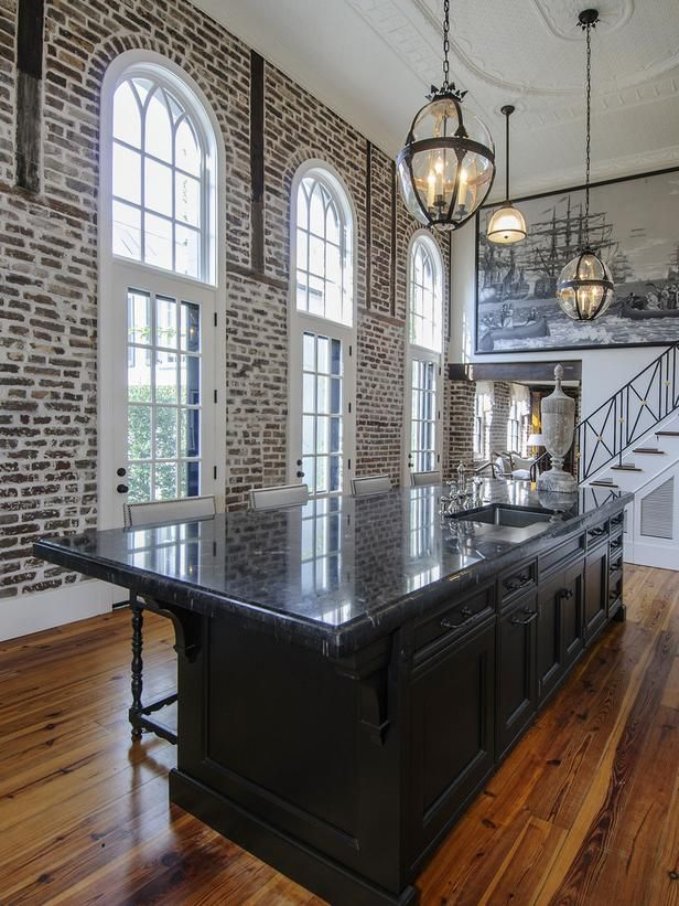 Love the arched windows and exposed brick in this kitchen!