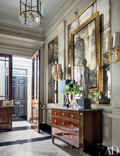 In Sawyer | Berson's makeover of a 1920s Manhattan apartment, the entrance hall features an antique Northern European commode from Newel topped by a fifth-century Chinese lohan figure | http://archdigest.com