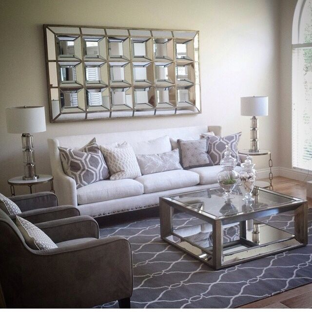 Mirror / couch / coffee table / rug