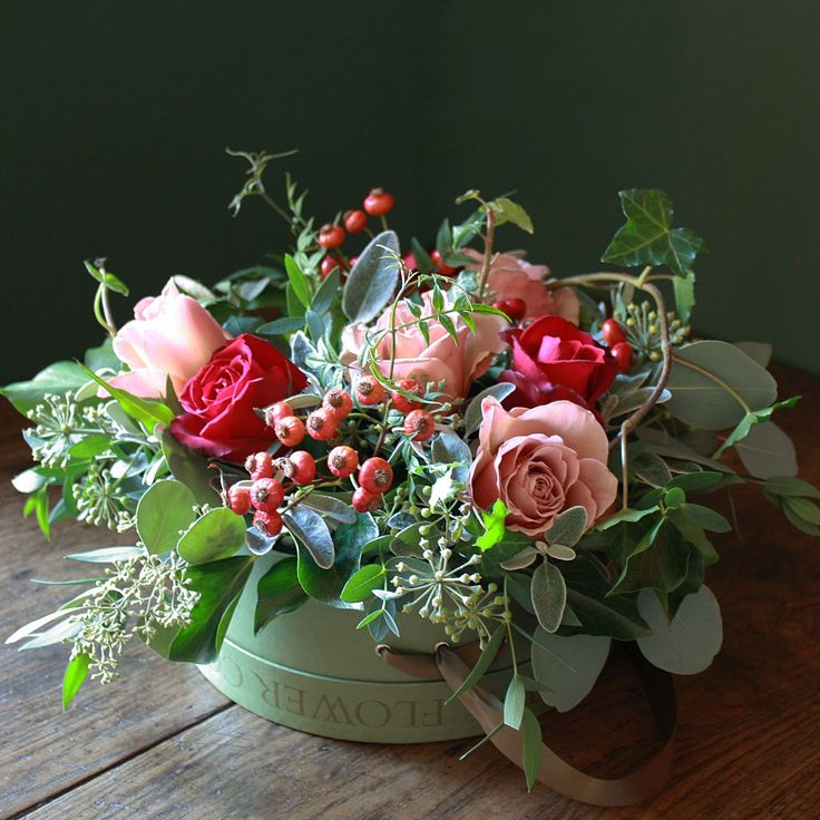 "Hat Box Arrangement filled with Red and Pink Roses, Herbs and Foliage ♥ Source: ""The Real Flower Company"" http://www.realflowers.co.uk/"