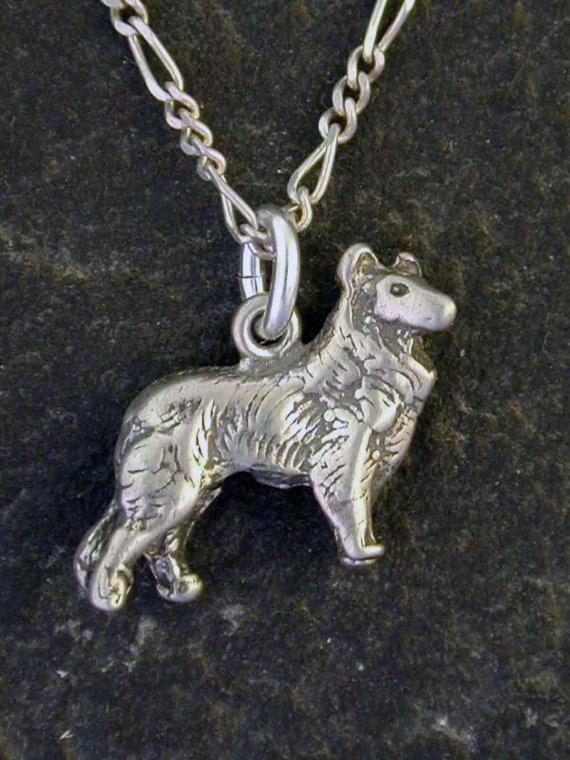 This solid 3 Dimensional Belgian Shepherd, a Tervueren or Groenendael Dog pendant is Sterling Silver. The included chain is a Sterling Silver Figaro
