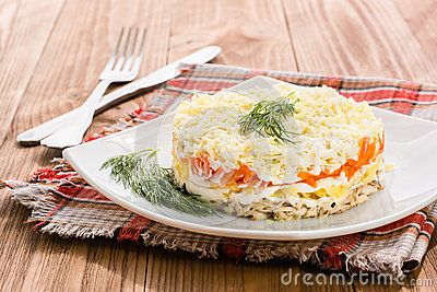 Russian salad with fish and vegetables Mimosa