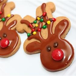 Reindeer cookies (use the gingerbread cutter upside down)  Great idea!
