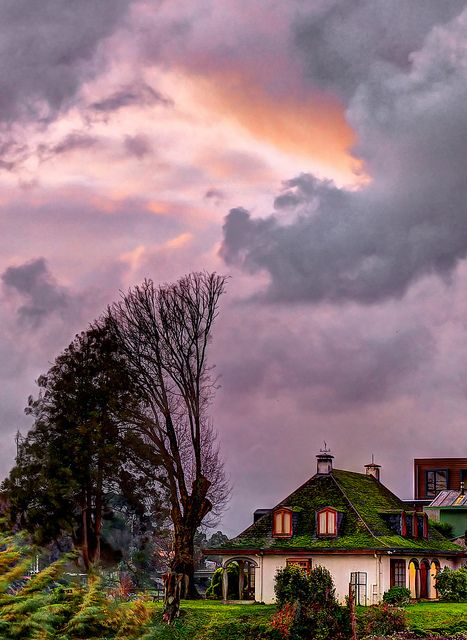 """'Stormy Skies over Southern Chile,' (Valdivia, Chile)   Flickr. Photographer wrote: """"An old house, one of the few remaining after the 1960 earthquake, under tempestuous skies in Valdivia, Chile."""""""