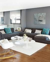 Like this color scheme for the living room, light gray walls, charcoal couch, blue accent pillows.