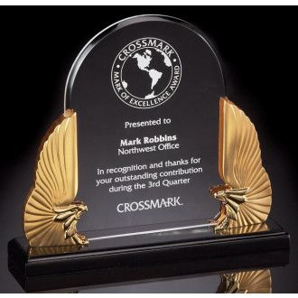 "Our Winged Eagle Acrylic Award features a dome shaped piece of acrylic for engraving mounted between two gold eagles with their wings spread, all mounted on a black base. This DT700 stands 10.5"" tall, weighs 3 lbs & includes free engraving."