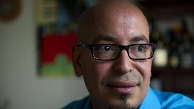 Rany Ibrahim, an immigrant from Egypt, says Canadians should set partisan politics aside, stick up for Canadian values and admit a large number of Syrian refugees. (INGRID BULMER/Staff)