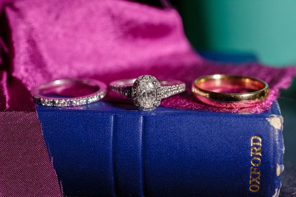 Vintage engagement ring idea - oval diamond and a halo setting + pavé band {C. Baron Photography}