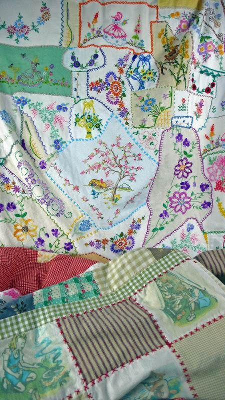 I wonder if I could bring myself to cut up my old linens...???!!!??  collaged crazy patchwork quilts