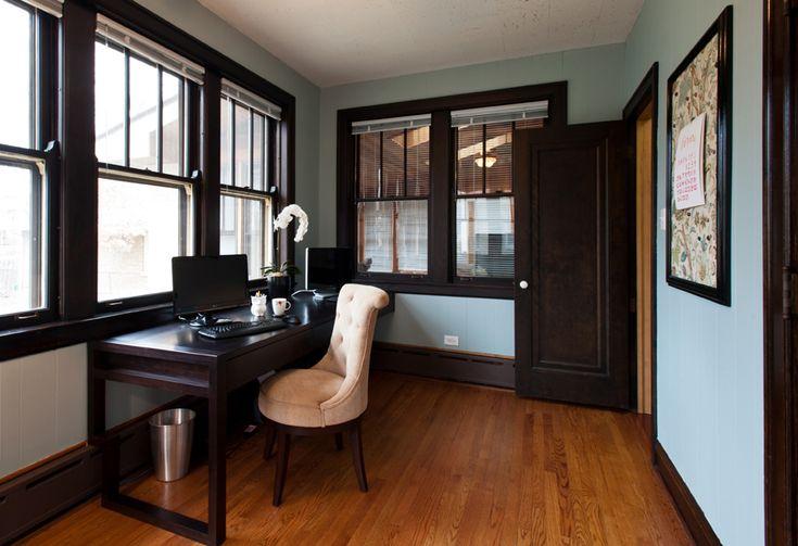 Great design website. home office, custom desk solution, dark wood trim and desk, medium wood floors, light teal wall color, no window treatments