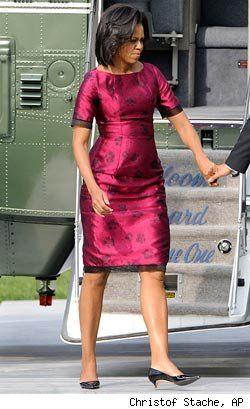 Michelle Obama in a classic shape - brilliant colour on her                                                                                                                                                     More