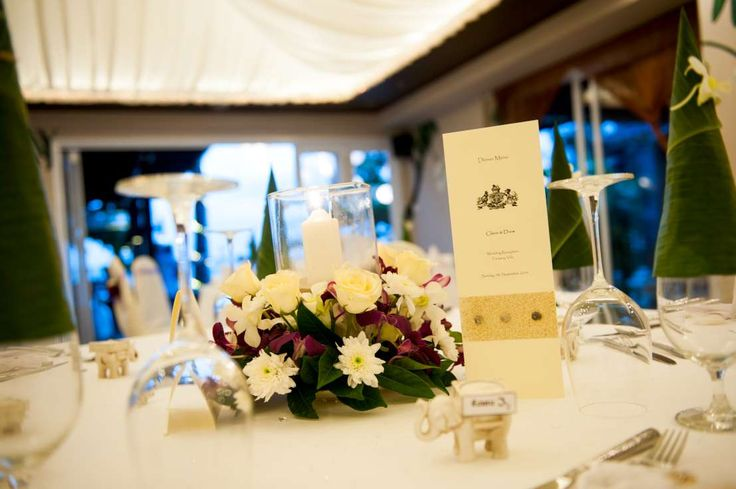 Singapore orchids white rose and mum centerpiece