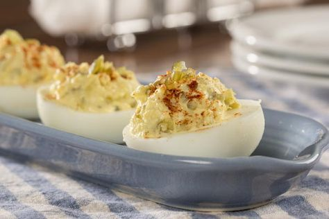 The next time you're invited to a get-together bring along a plate of Southern Deviled Eggs. This deviled egg recipe is a simple one and calls for some of our favorite, classic ingredients, like mayo and sweet pickle relish. It's a recipe any Souther