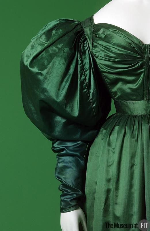 "Museum at FIT, item #P88.28.1 c1830 green silk satin afternoon dress. English. The deeply saturated color of the dress represents a tendency towards the use of darker, more vivid hues. Traditionally symbolizing nature, the color green, with its connotations of luck in Ireland and sanctity in the Islamic religion, is reflective of the ""exoticism"" that was popular during the Romantic periods."