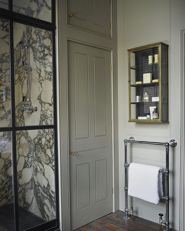 Traditional marble with industrial glass panelling and breccia verde marble bathroom slab