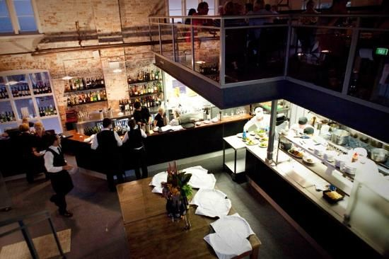 Our open kitchen and bar area adds a great element to our historic buidling