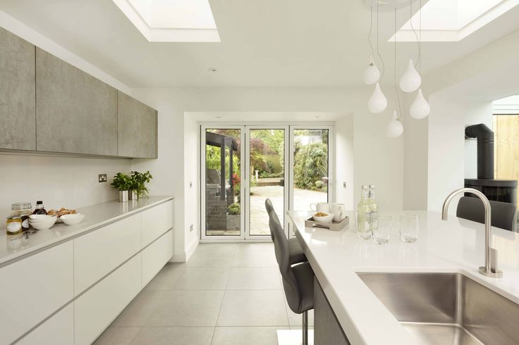Large floor-to-ceiling doors and windows not only flood a space with natural light, but also offer easy access to the garden for entertaining in the warmer months