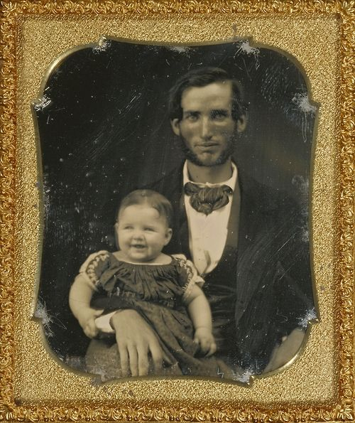 Yes, they smiled back then. Sweet bitty girl, happy Papa! Portrait of a Father and Smiling Child, about 1855, Daguerreotype. J. Paul Getty Museum