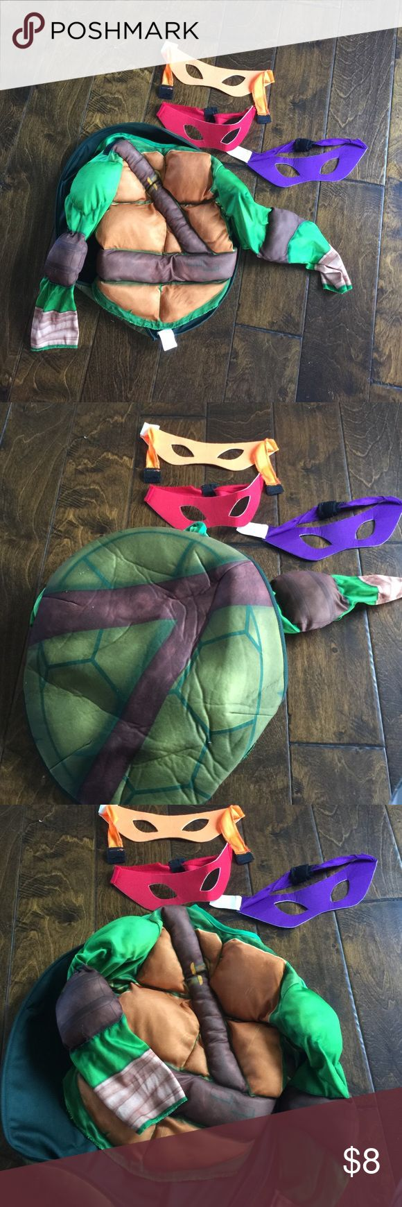 Boys nija turtle outfit Fits boys 3-5 nija turtle outfit has she'll back and 3 different masks. In good condition Costumes Superhero