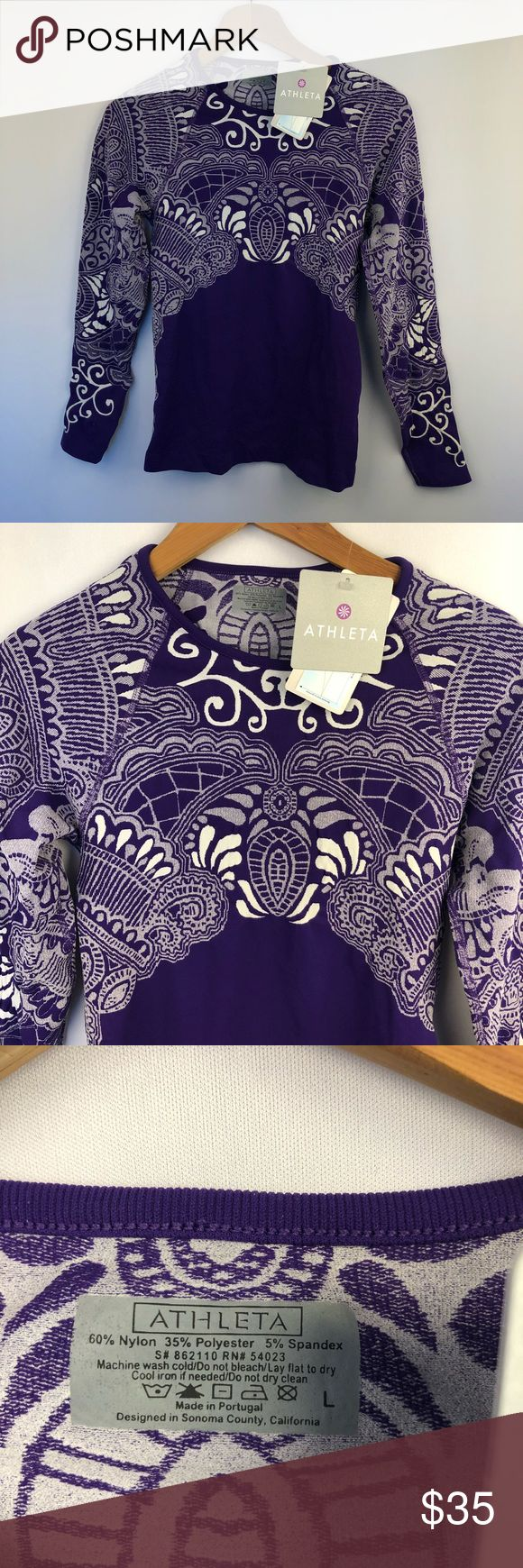 Athleta Tattoo Twist athletic Top, Size Large Athleta Tattoo Twist Top Women's size Large Features Q-skin technology  Dark purple and white Total le…