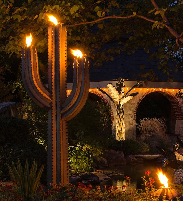 Saguaro Cactus Outdoor Torch | Deck | Here's a fresh take on the classic tiki torch: the Saguaro Cactus Garden Sculpture includes three torch canisters for adding southwestern ambience to your outdoor evening gatherings. Made in America of galvanized steel, the intricately detailed luminary and sculpture in one resists rust and corrosion even near the beach. Green verdigris patina gives it lifelike color.